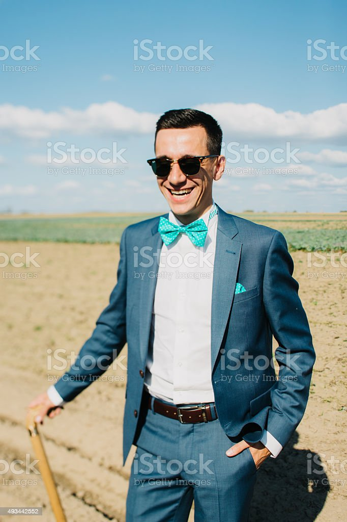 stylish costume guy in the field stock photo