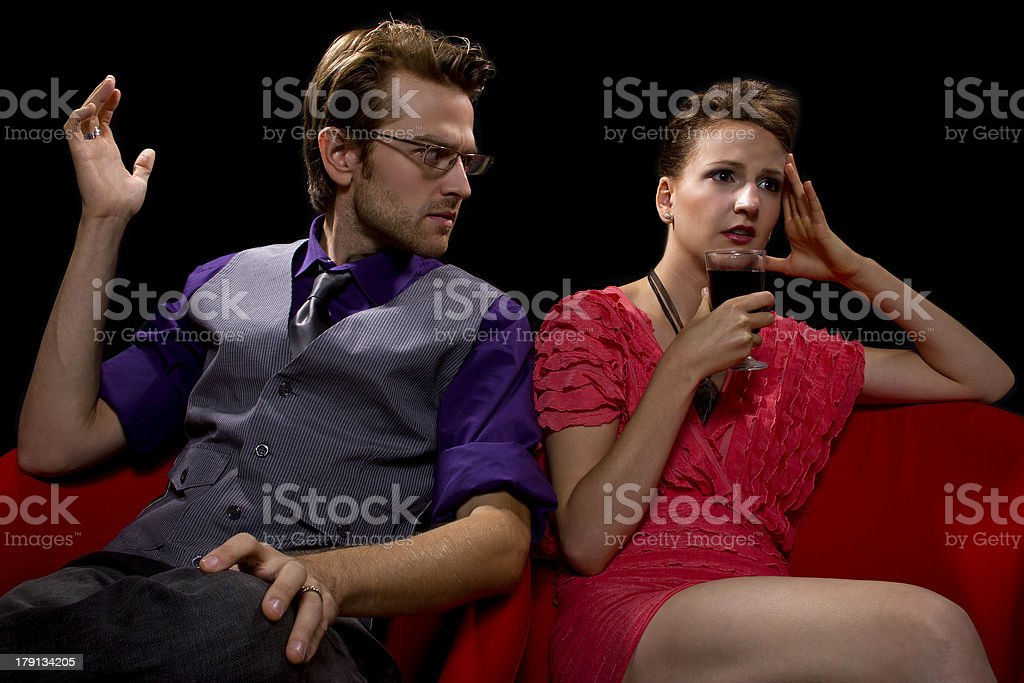 Stylish Couple Fighting on a Date While Woman Drinks Wine royalty-free stock photo