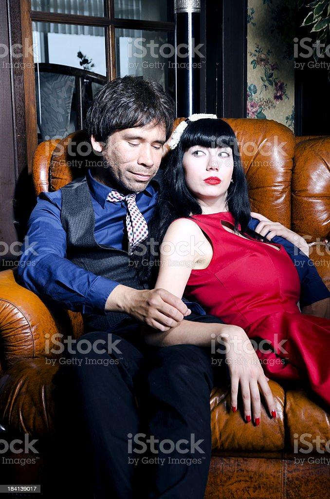 Stylish couple in retro setting stock photo
