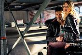 Stylish couple on a motorcycle