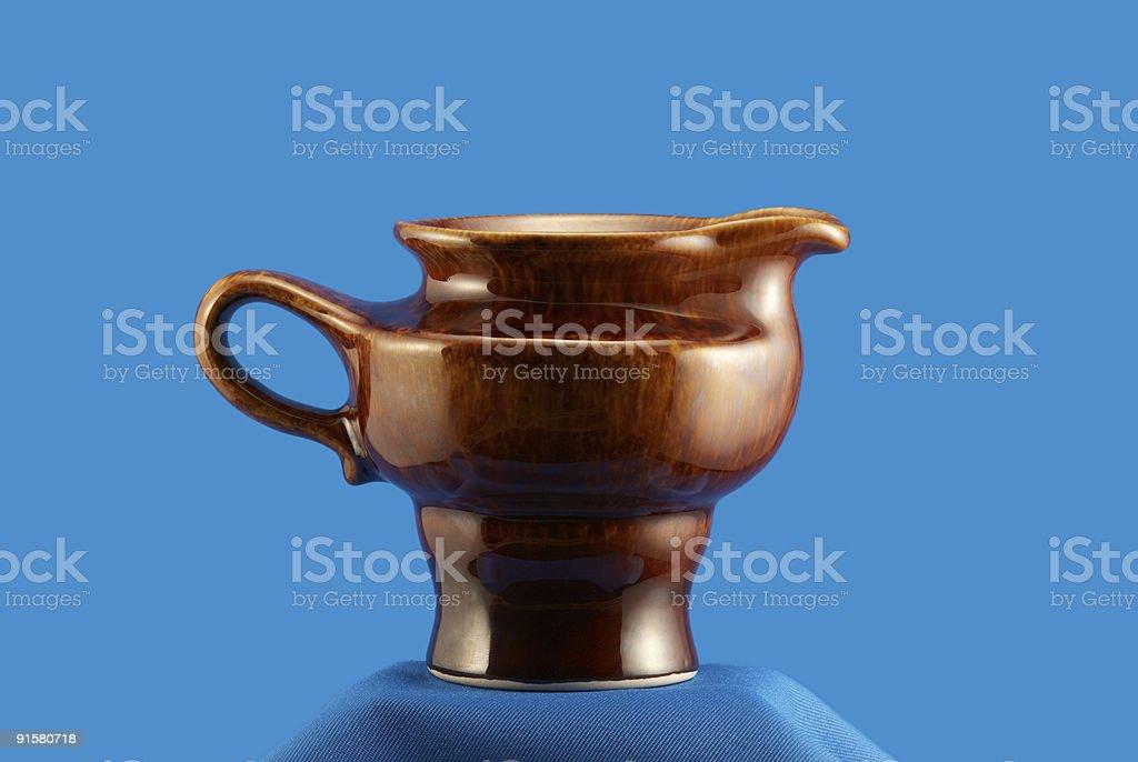 Stylish east milk jug on blue royalty-free stock photo