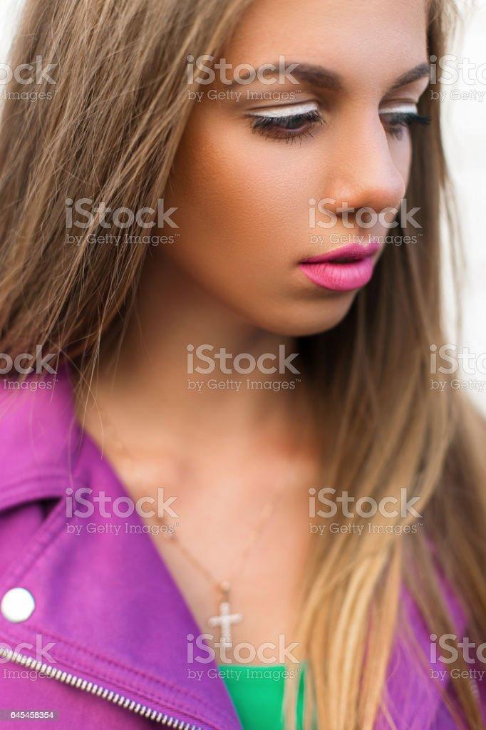 Stylish fashion portrait of a beautiful woman with bright lips and a jacket stock photo