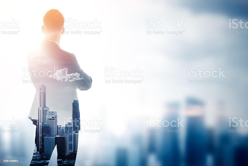 Stylish gentleman in trendy suit. Double exposure skyscraper on the stock photo
