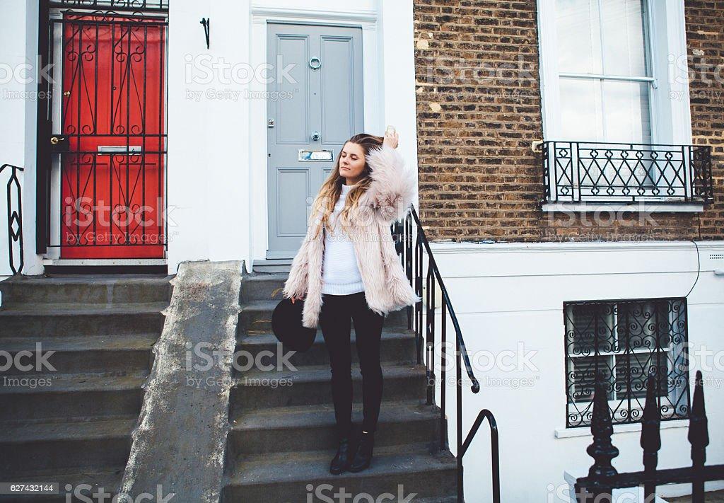 Stylish girl in fauxfur stock photo
