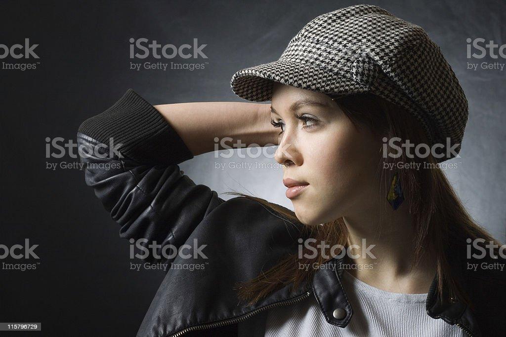 Stylish girl wearing cap royalty-free stock photo