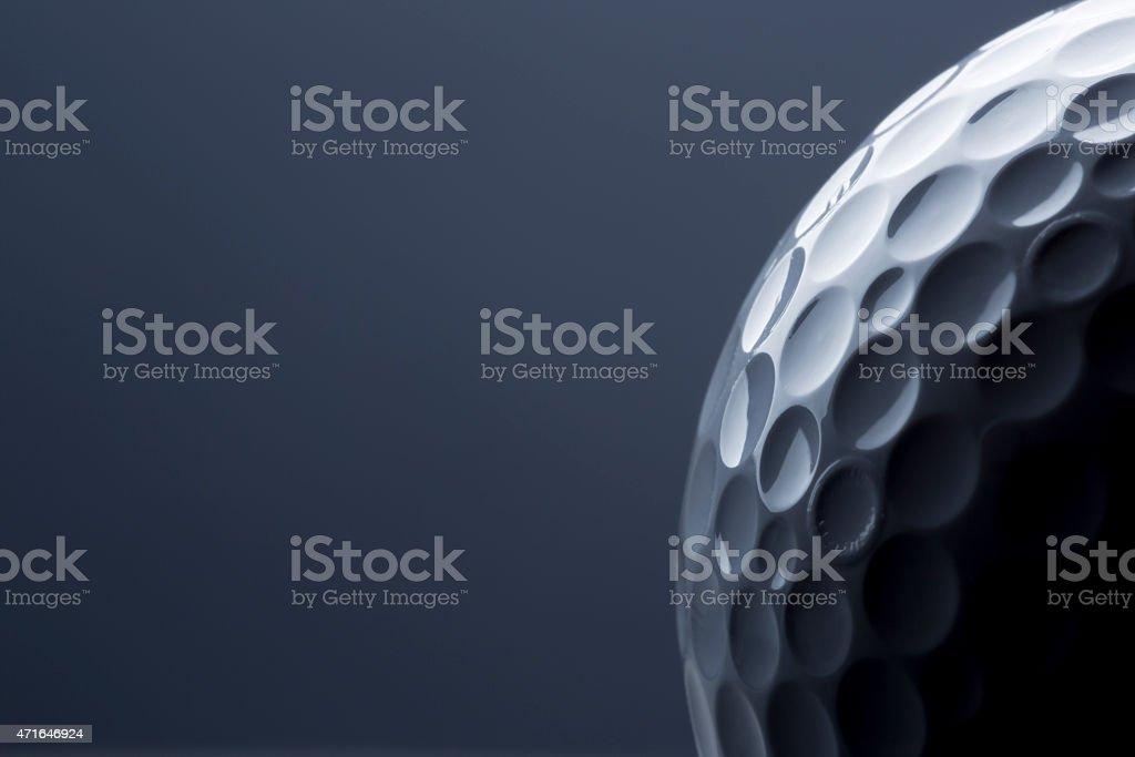 Stylish golf ball isolated on empty dark blue background. stock photo