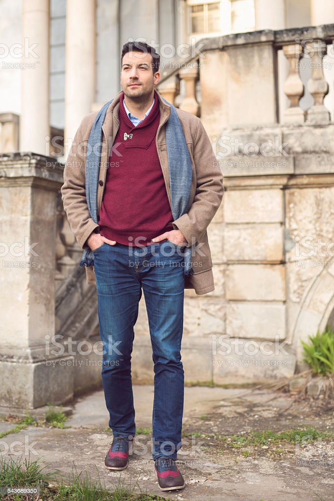 Stylish guy in a rustic ambience stock photo