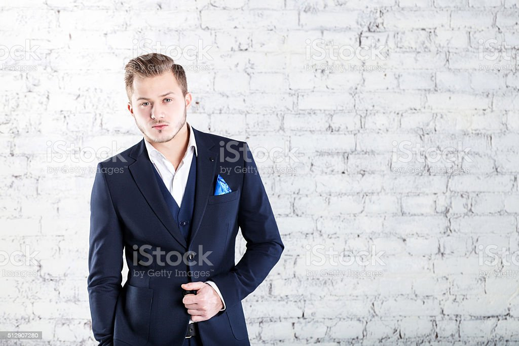 Stylish handsome. Confident young businessman adjusting his eyew stock photo