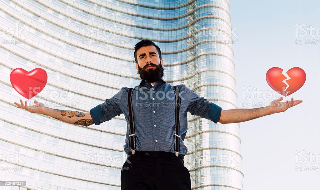 Stylish Hipster holding heart shapes stock photo
