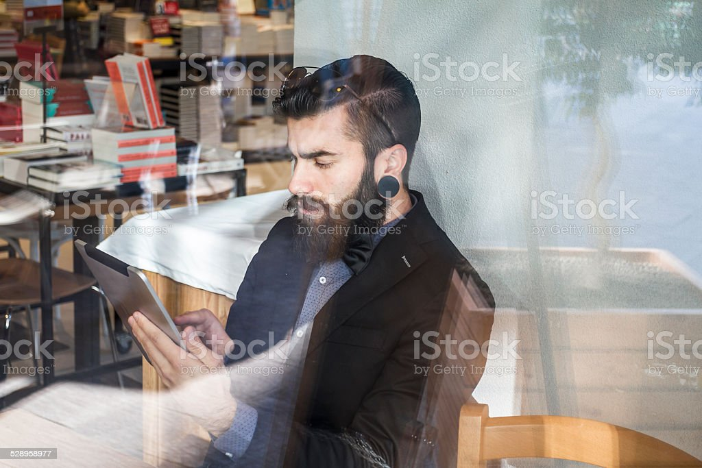 Stylish Hipster in a coffee shop stock photo