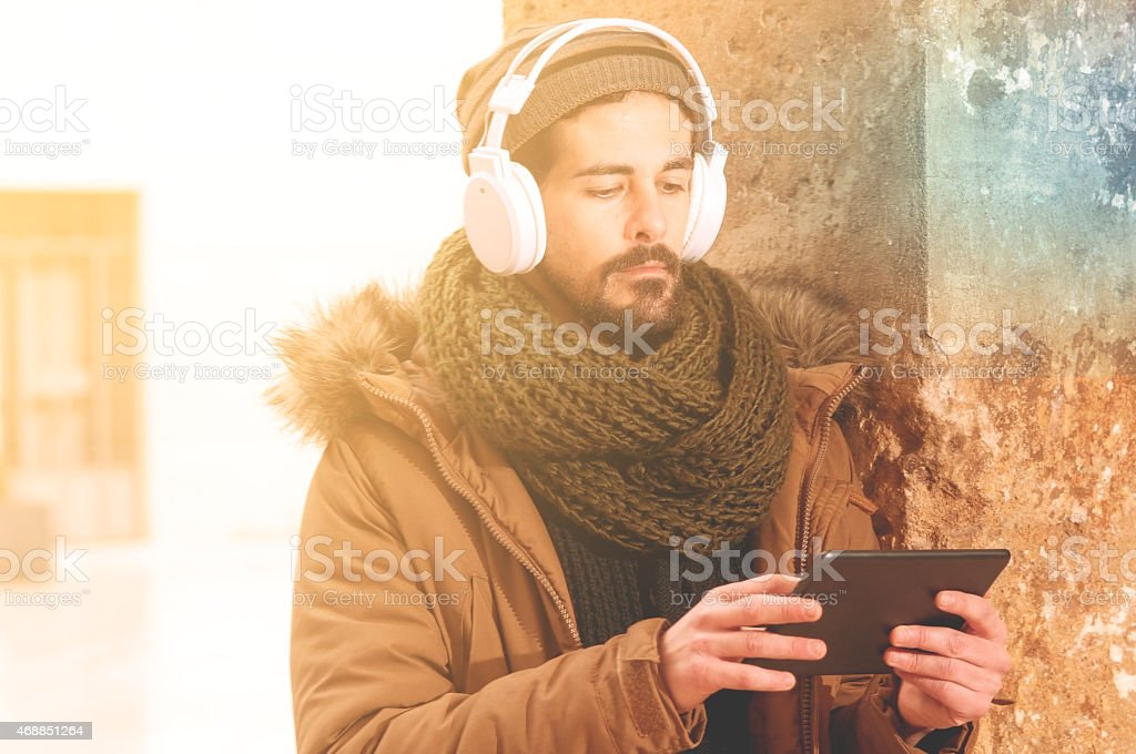 stylish hipster using table with a warm tone filter applied stock photo