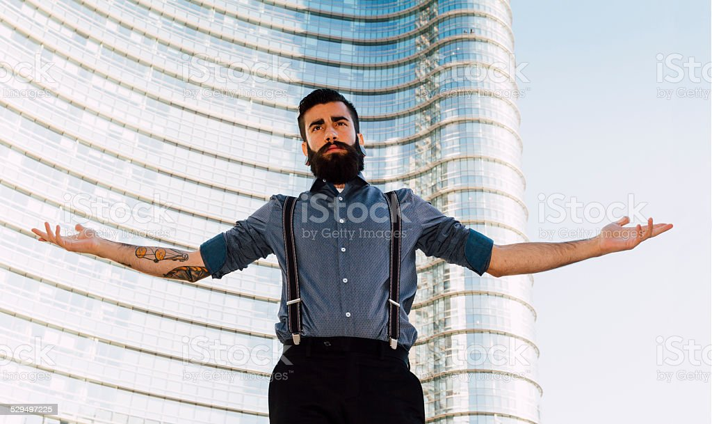Stylish Hipster with open arms stock photo