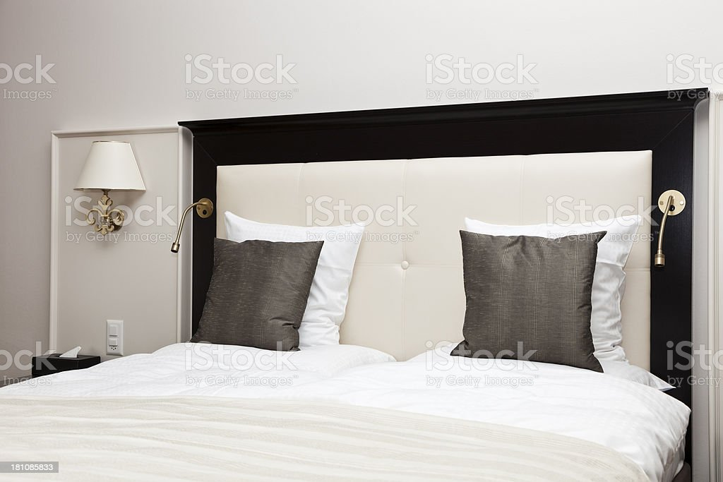 Stylish Hotel Bed royalty-free stock photo