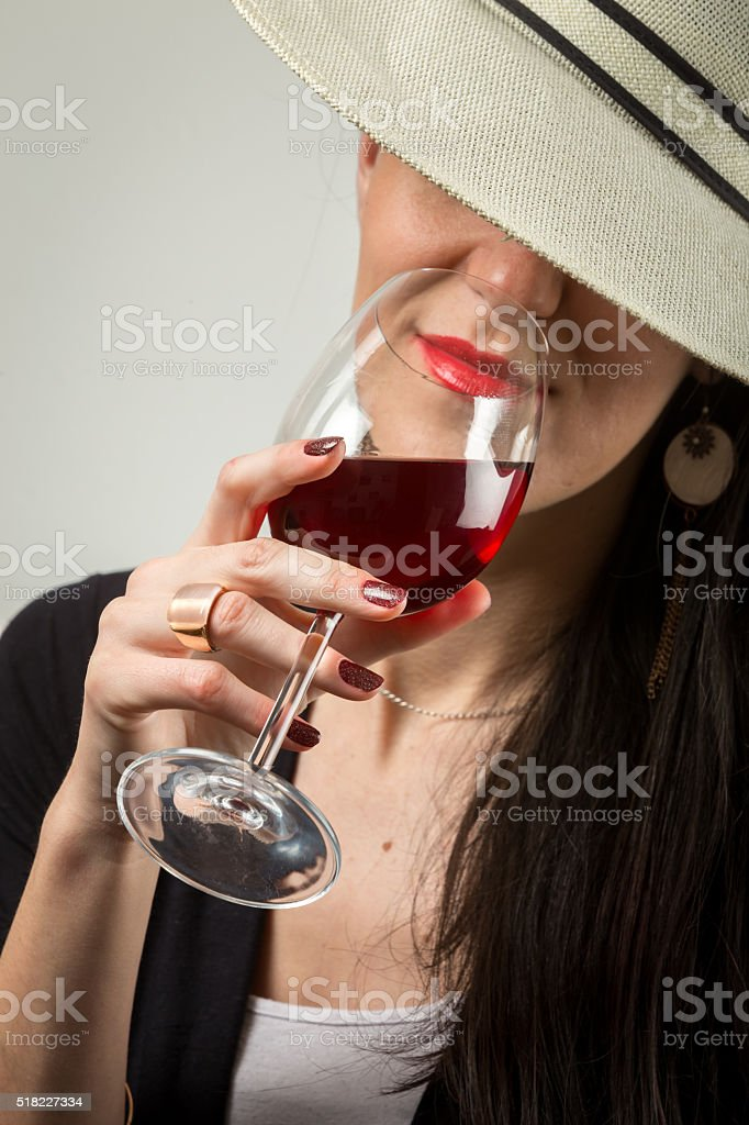Stylish lady with red vine. stock photo