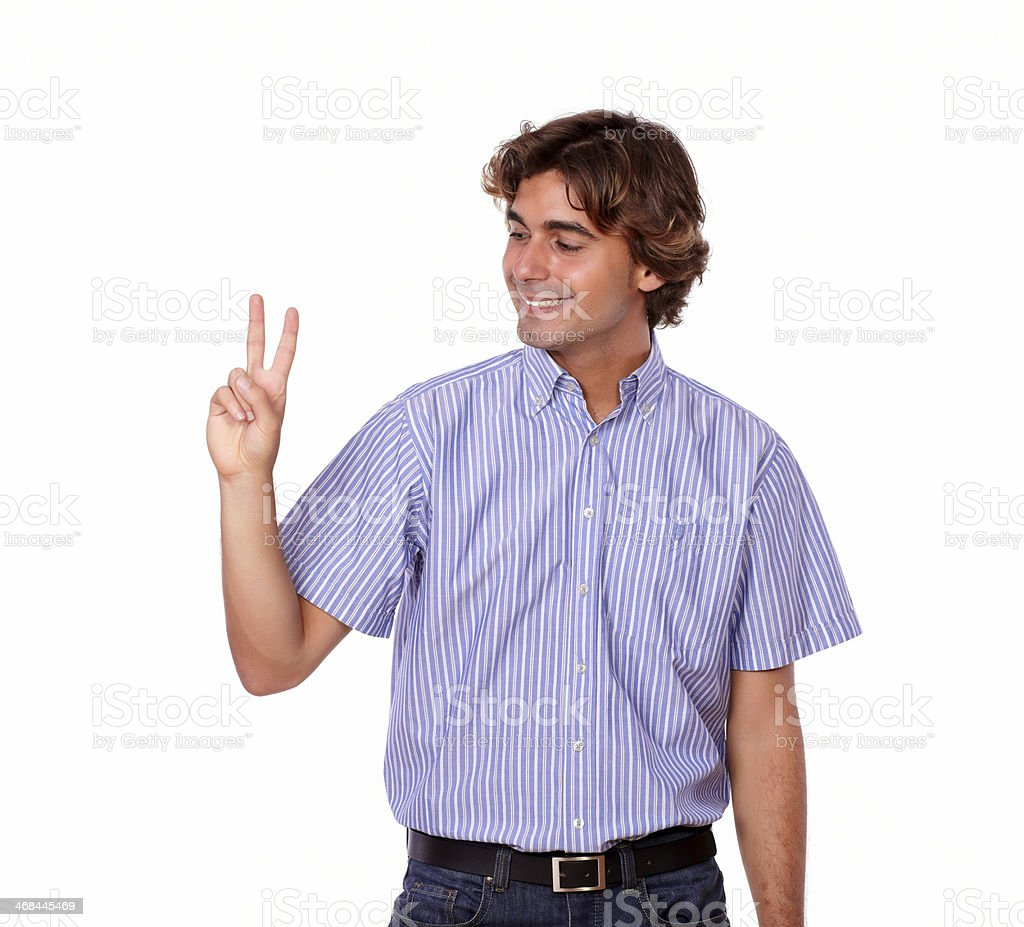 Stylish latin man smiling positive with victory royalty-free stock photo