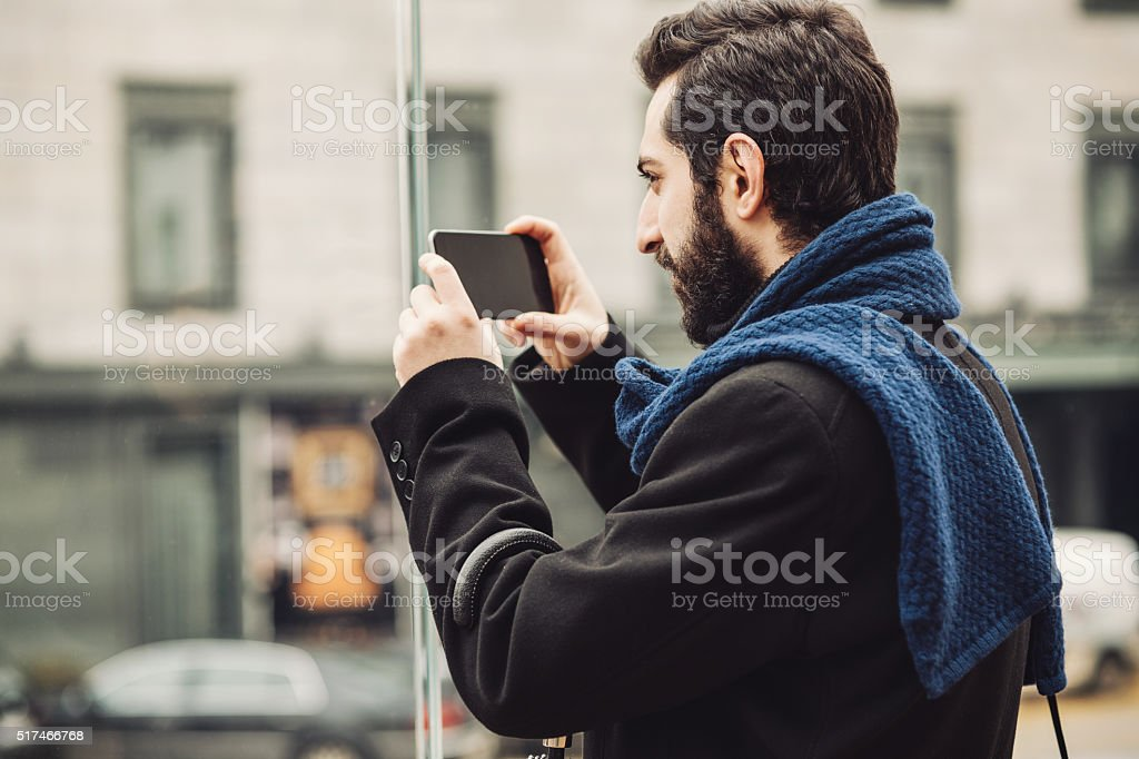 Stylish male taking puctures stock photo