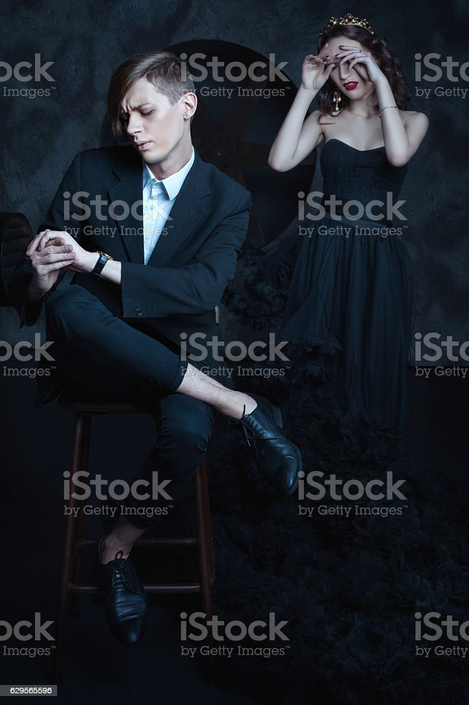 Stylish man and weeping queen. stock photo