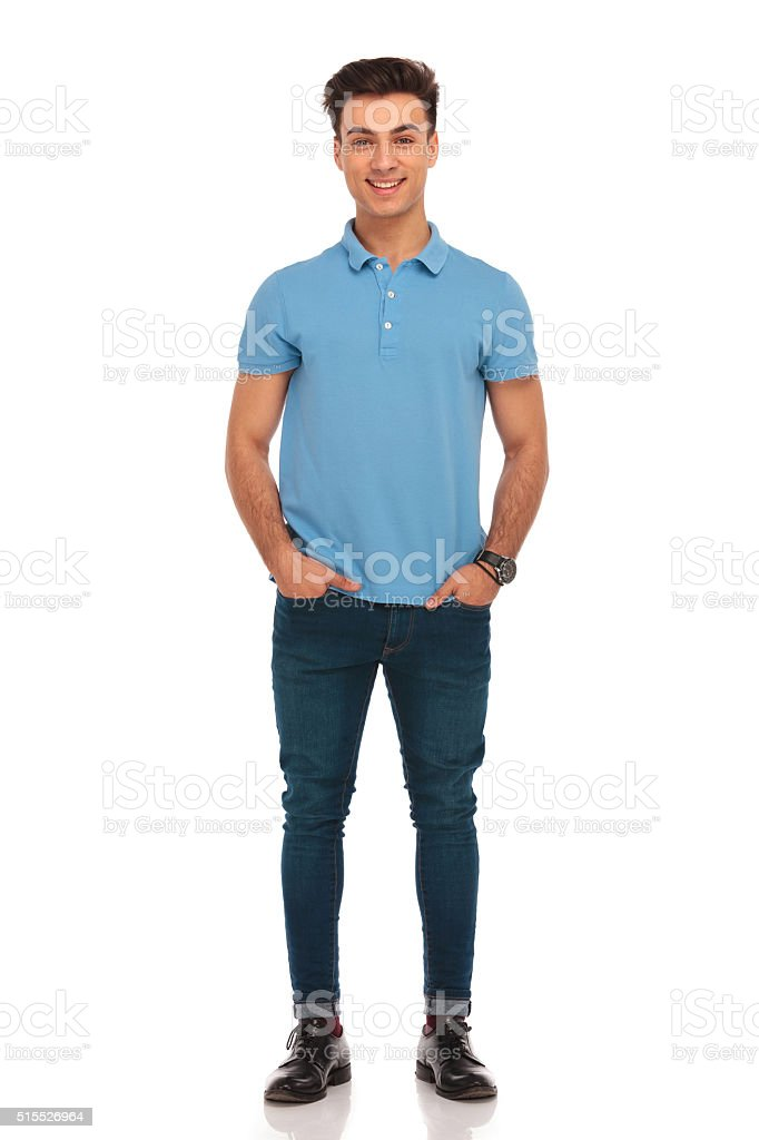 stylish man in blue posing with hands in pockets stock photo