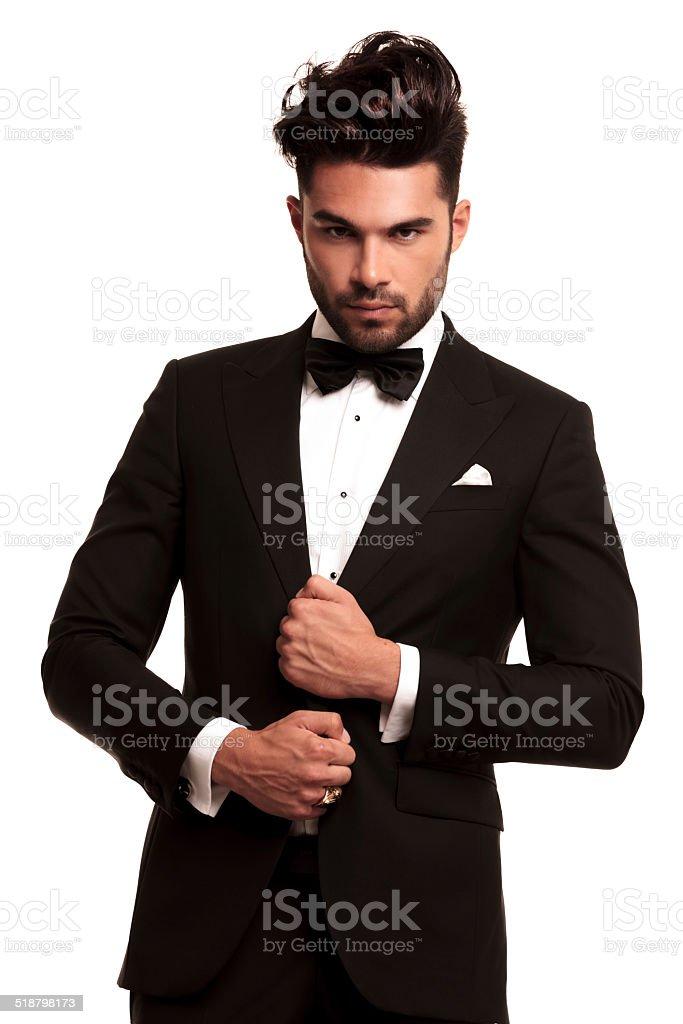 stylish man in elegant black suit and bowtie stock photo