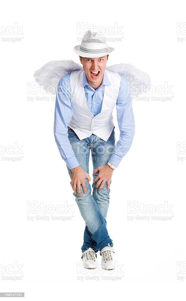Stylish man in image of angel posing on white stock photo