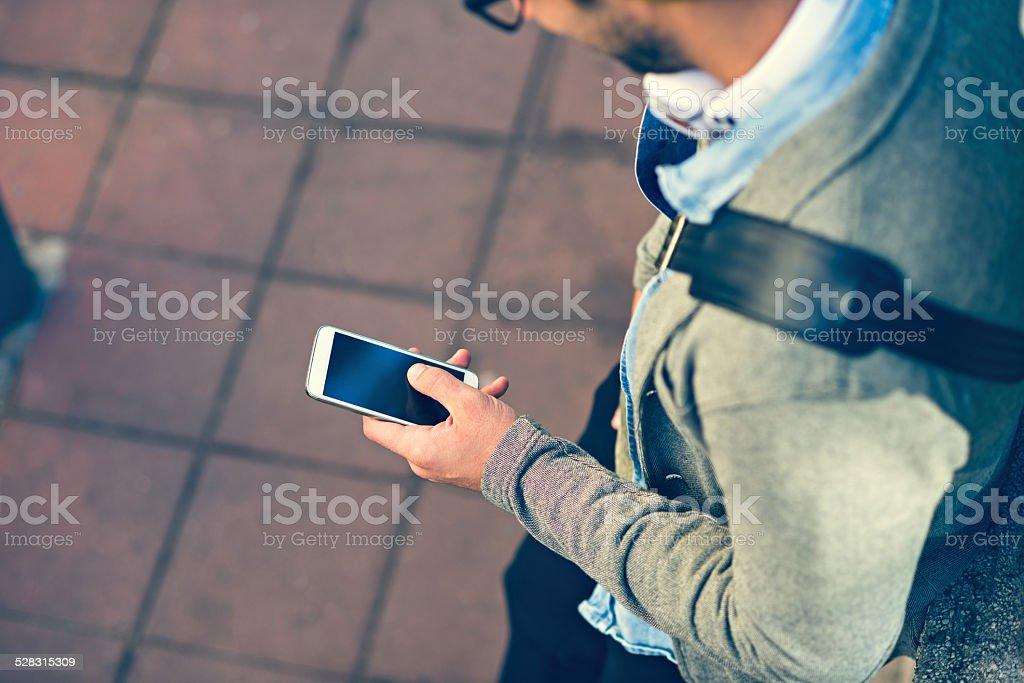 stylish man typing text message stock photo
