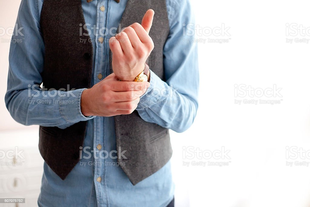stylish man wears watches. stock photo
