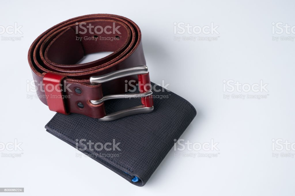 Stylish men accessories. Notebook, brown leather belt and a black wallet on a white background. stock photo