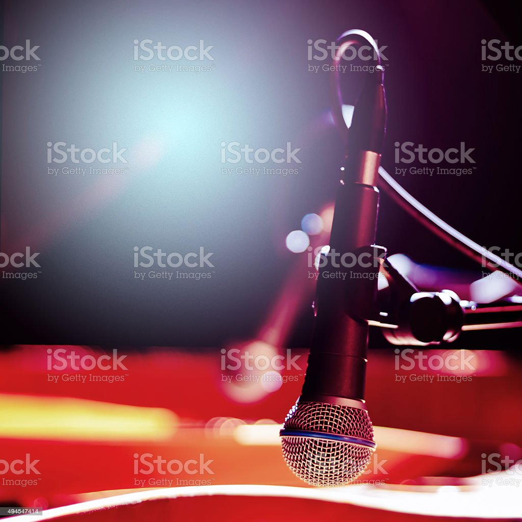 Stylish Microphone on a Blurred Colored Background stock photo