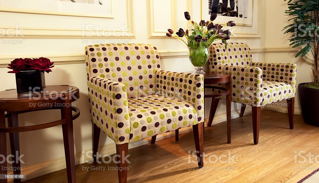 stylish modern waiting room with empty upholstered chairs royalty-free stock photo
