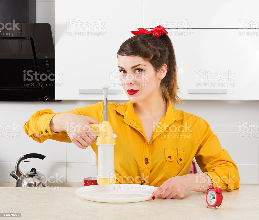 Stylish pin-up housewife stock photo