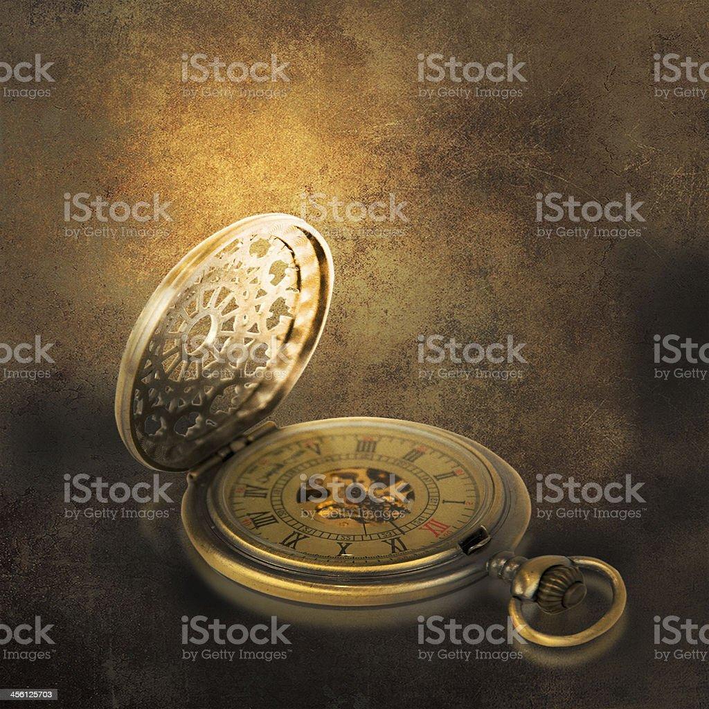 Stylish pocket watch on the grunge background. stock photo