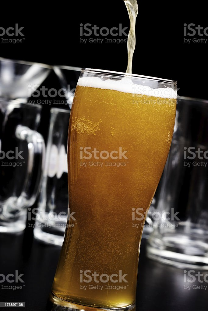 Stylish portrait of pouring beer in a glass royalty-free stock photo