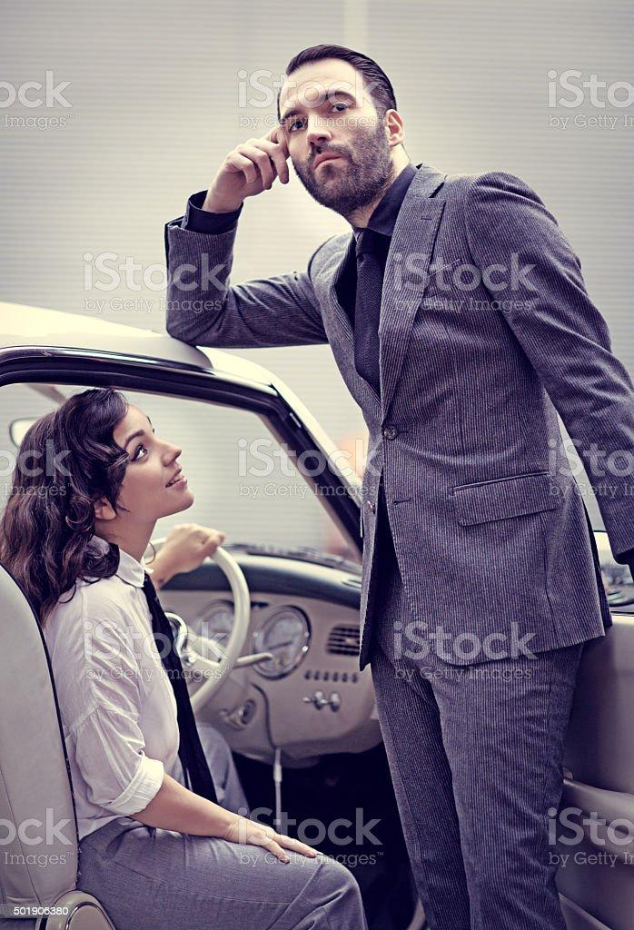 Stylish retro couple in a vintage car stock photo