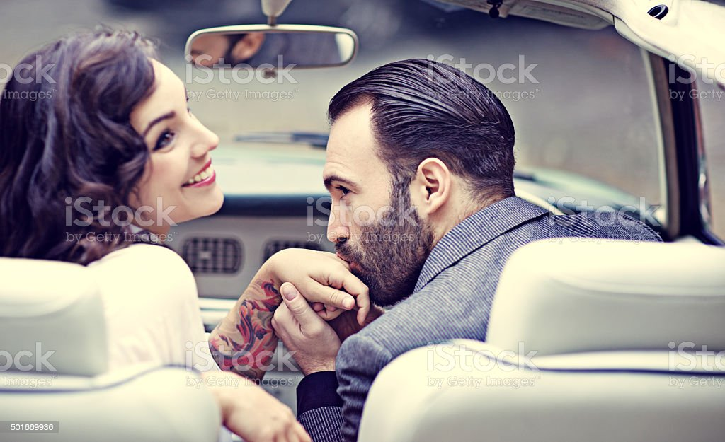 Stylish retro couple in love in a vintage car stock photo