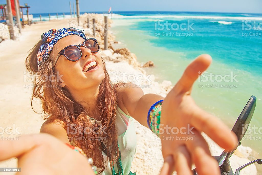 stylish selfie on a beach while riding a motorbike stock photo