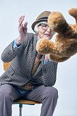 Stylish senior woman with teddy bear