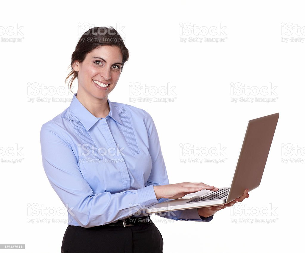 Stylish smiling young woman using a laptop royalty-free stock photo