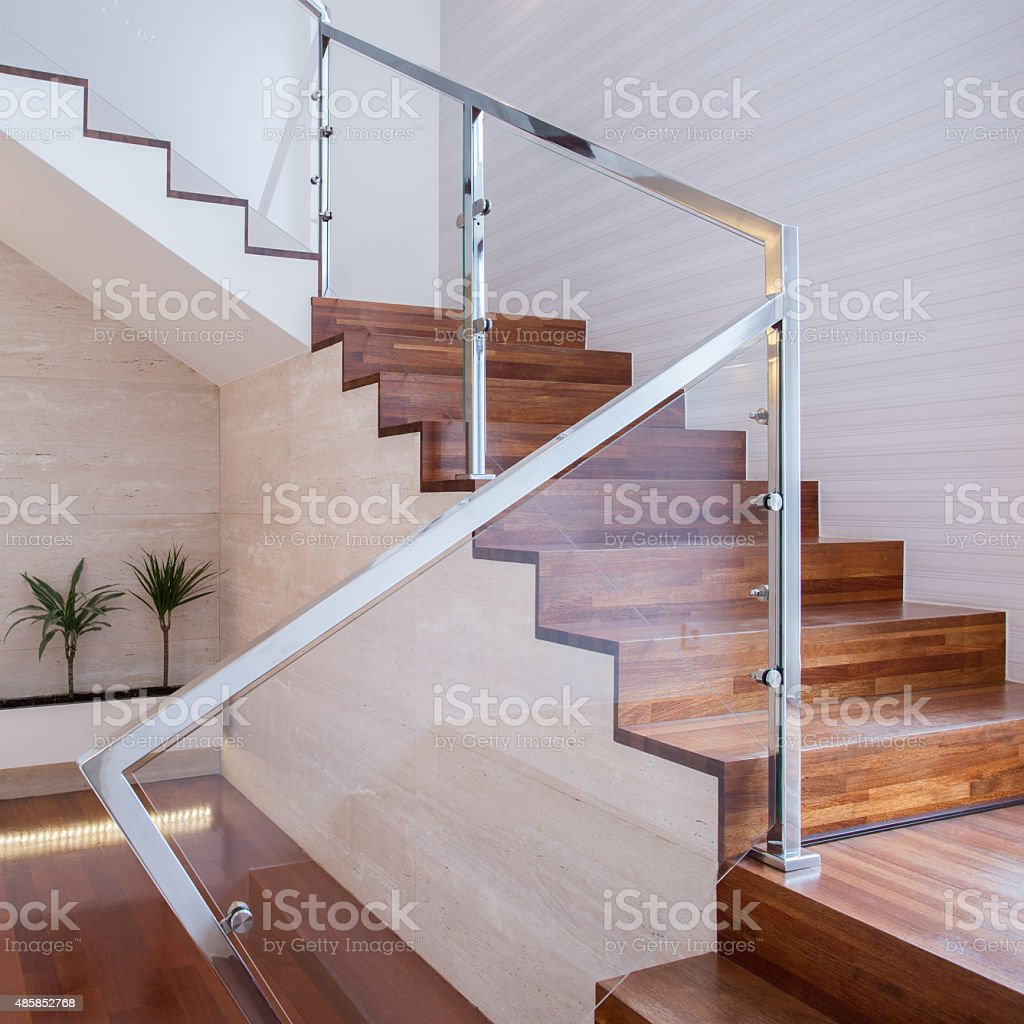 Stylish staircase in bright interior stock photo
