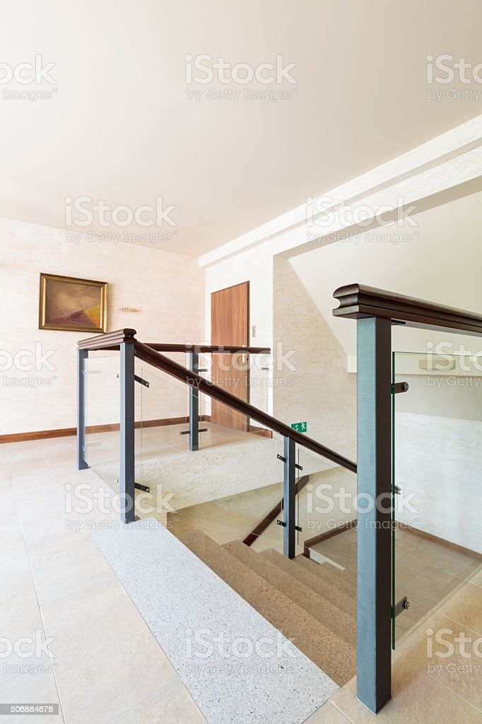 Stylish staircase with glass railing stock photo