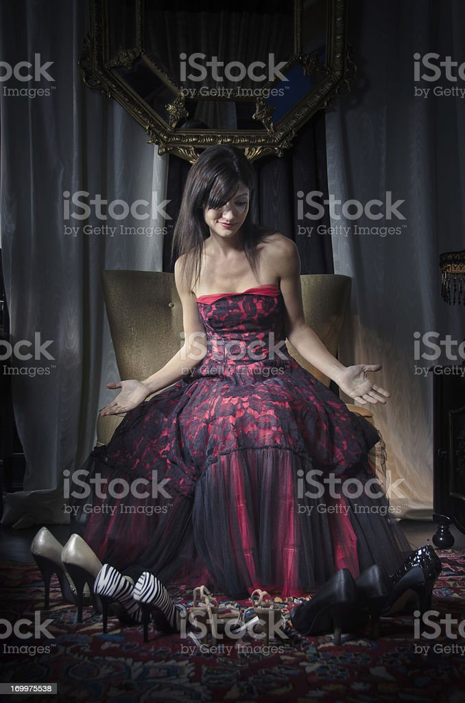 Stylish Woman Choosing Shoes stock photo