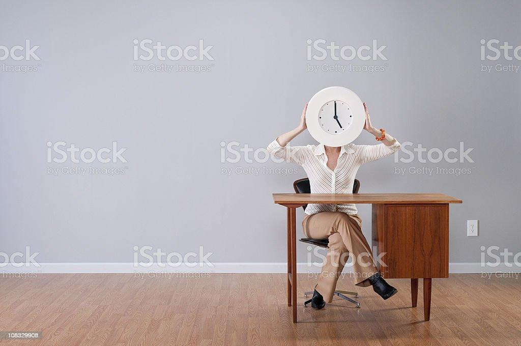 Stylish Woman Holding Clock stock photo