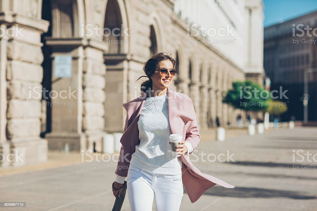 Stylish woman in a hurry stock photo