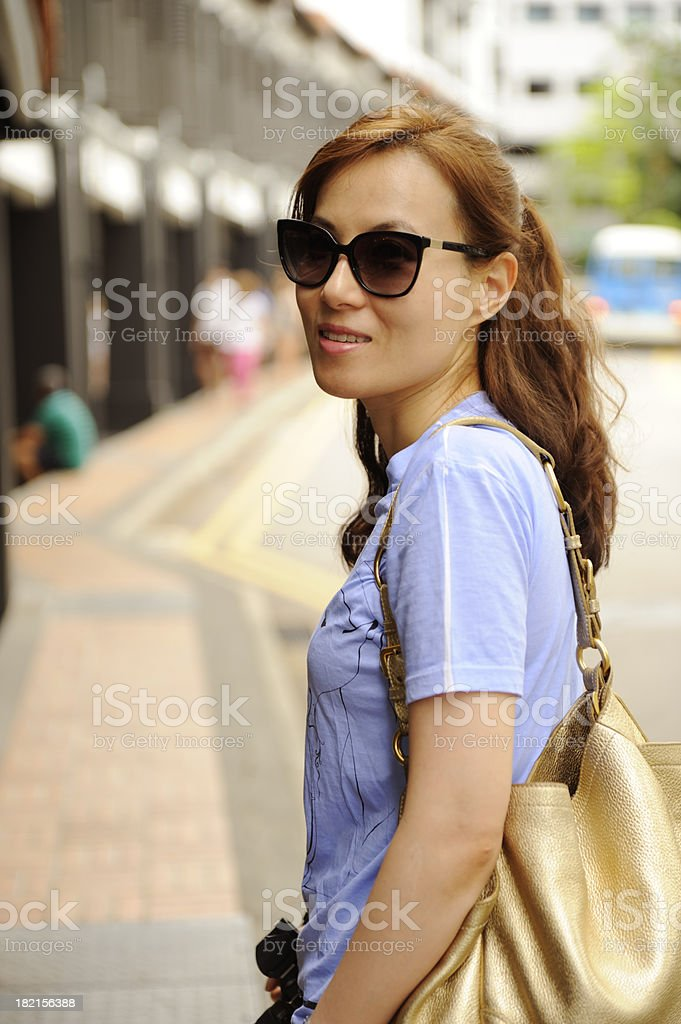 Stylish woman in downtown royalty-free stock photo