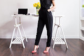 Stylish Woman standing in front of her desk