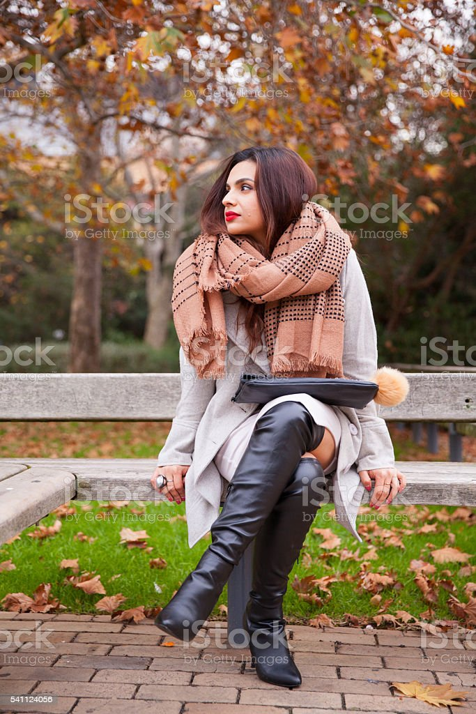 Stylish Woman Waiting in the Park stock photo