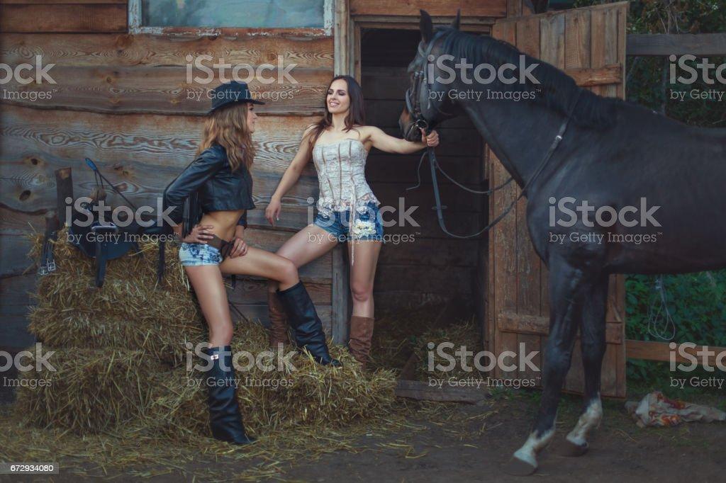 Stylish women cowboys. stock photo