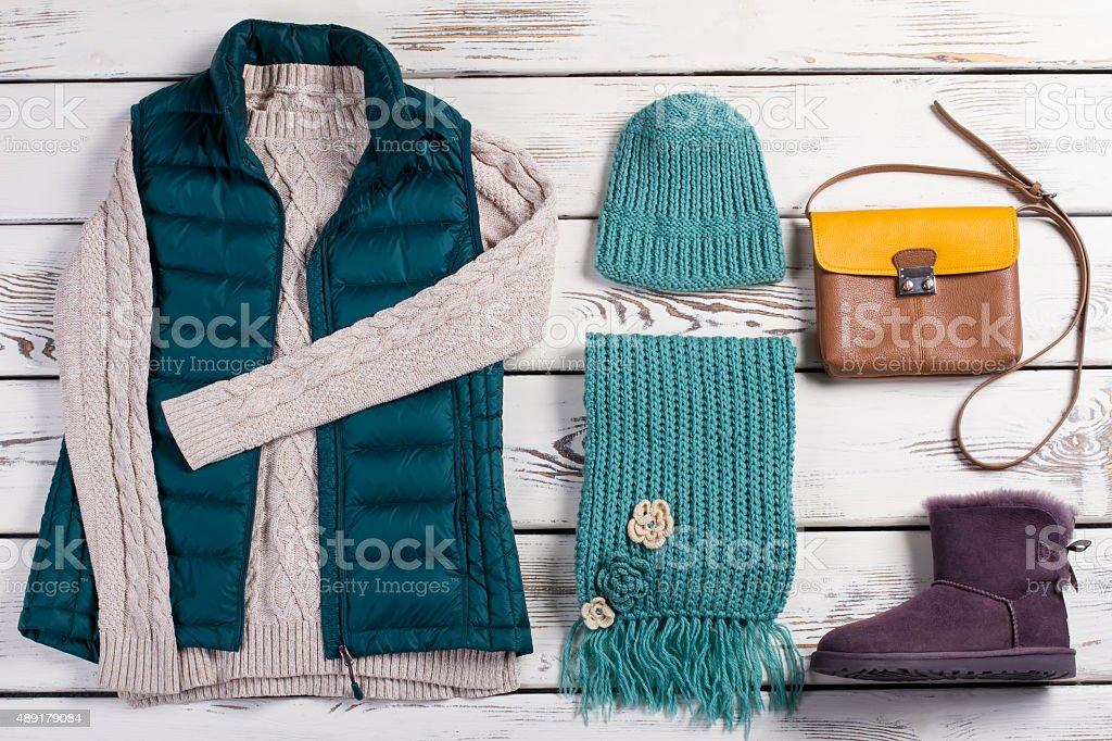 Stylish women's clothing on a wooden background. stock photo