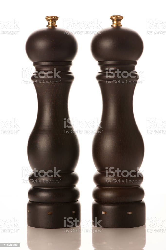 Stylish wooden salt and pepper mill isolated over white stock photo