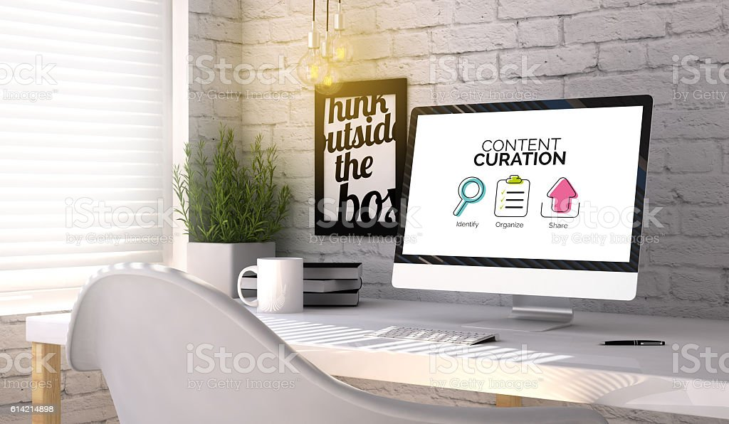 Stylish workplace with computer with Content curation concept on stock photo