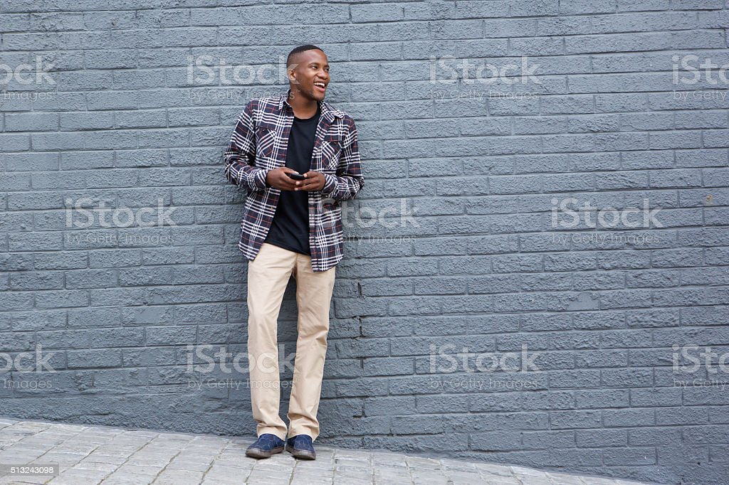 Stylish young african man looking at copy space stock photo